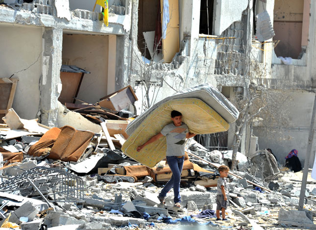 Palestinian Searches Through Rubble in Towers Al-andaa, Gaza