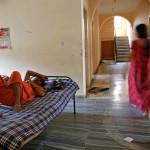 "A surrogate mother (L) rests inside a temporary home for surrogates, provided by Akanksha IVF centre, in Anand town, about 70 km (44 miles) south of the western Indian city of Ahmedabad August 24, 2013. India is a leading centre for surrogate motherhood, partly due to Hinduism's acceptance of the concept. The world's second test tube baby was born in Kolkata only two months after Louise Brown in 1978. Rising demand from abroad for Indian surrogate mothers has turned ""surrogacy tourism"" there into a billion dollar industry, according to a report by the Law Commission of India. Picture taken August 24, 2013. REUTERS/Mansi Thapliyal (INDIA - Tags: HEALTH SOCIETY)     ATTENTION EDITORS: PICTURE 05 OF 33 FOR PACKAGE 'SURROGACY IN INDIA'  TO FIND ALL IMAGES SEARCH 'SURROGACY ANAND' - RTR3FFE9"