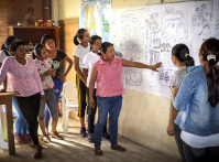 Zunilda Arce (center) and young women from the Ita Guasu indigenous community in Paraguay, participate in the development of their community development plan. This activity is part of USAID's efforts to strengthen civil society participation in municipal governance. Through its local partner Federation of Production Cooperatives (FECOPROD), USAID also works with indigenous communities to help them identify and advocate for their needs within a political context. /Luciano González, FECOPROD