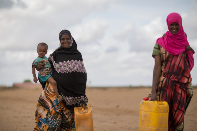Girls in jigjiga, jila alu kebele on their way to fetch water from the nearby water point which is recently started by unicef/ethiopia. they explain, their life is much improved in which they get cleaner water in their nearby. ©UNICEF Ethiopia/2016/Tesfaye