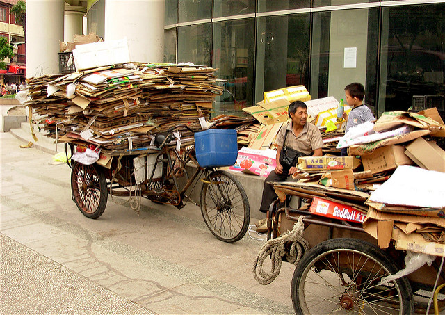 Man sits with his freight bike of recyclabel materials