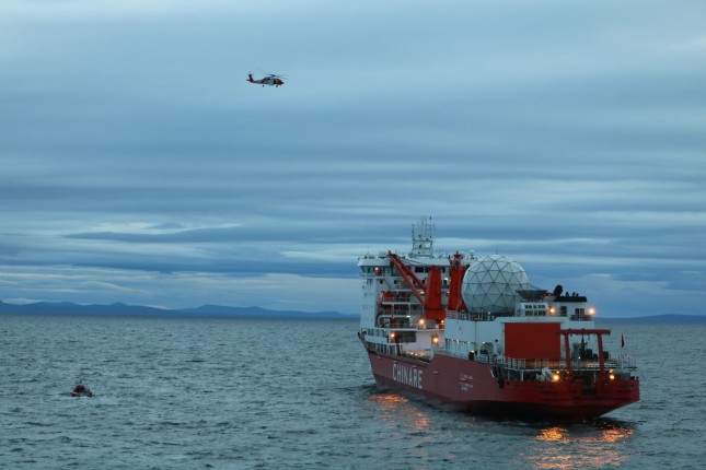 A smallboat crew from the Coast Guard Cutter Alex Haley medevacs a man suffering a broken arm from the Chinese research vessel Xue Long, 15 nautical miles from Nome, Alaska, Sept. 23, 2017. The smallboat crew embarked the man and transferred him to the Alex Haley for further transfer to Nome, Alaska. U.S. Coast Guard photo.