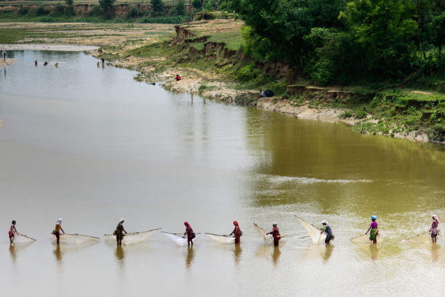 Women fishing in the Terai region of Nepal. The USAID Paani program will enhance Nepal's ability to manage water resources for multiple uses and users through climate change adaptation and the conservation of freshwater biodiversity. Photo by Olaf Zerbock, USAID.