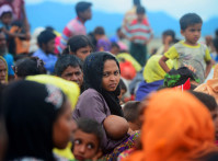 Rohingya,Refugees,Cross,Into,The,Mainland,After,Arriving,In,Bangladesh