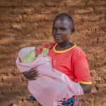 Joyce Makasi holding her baby Charity-1