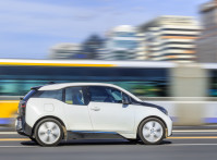 BEIJING-OCTOBER 28, 2016. BMW i3 electric car downtown. Researchers and trend watchers predict that electric cars will account for two thirds of the cars on the roads of 50 major world cities by 2030.