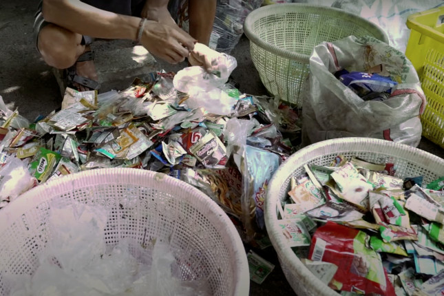 a person sorting plastic waste
