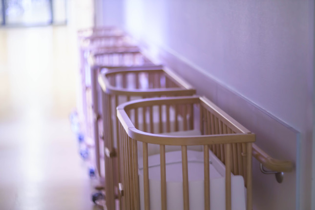 Close,Up,Of,A,Range,Of,Empty,Baby,Beds,In