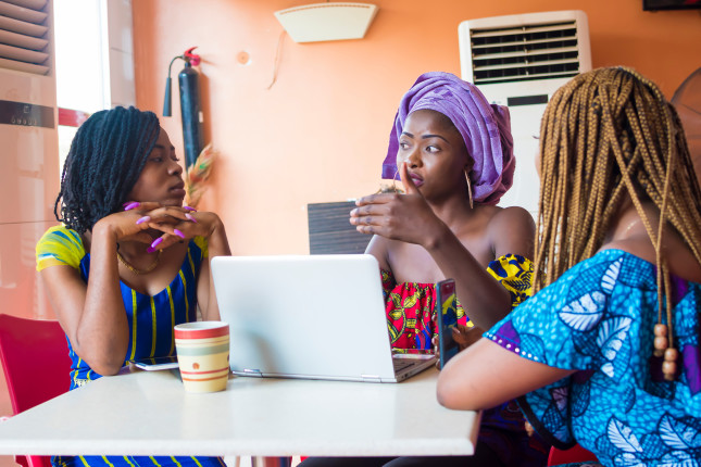 Group,Of,Young,African,Women,Discussing,Something,Important.,Three,African