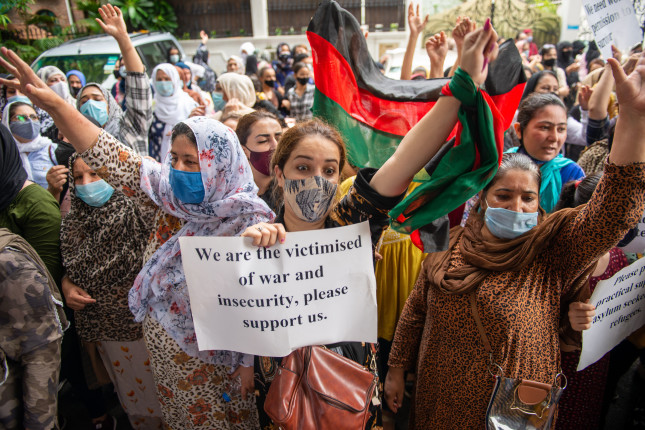 New,Delhi,,India-aug,24,2021:,Afghan,Women,Holding,Placard,Protesting