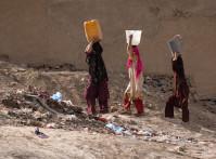Kabul,,Afghanistan,,Mar,2004:,Women,Carrying,Water,In,Kabul,,Afghanistan