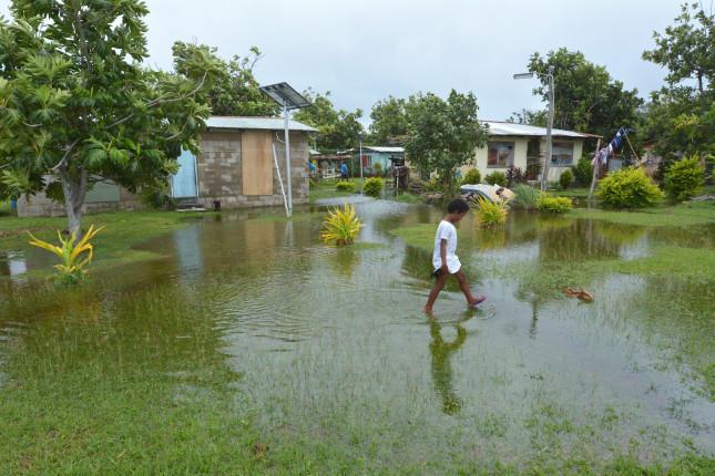 Indigenous,Fijian,Girl,Walking,On,Flooded,Land,In,Fiji.,On