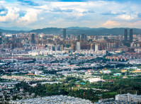 Kunming city skyline panorama with buildings of downtown area in Yunnan China